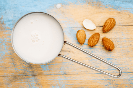 Can you freeze almond milk? A measuring cup full of almond milk